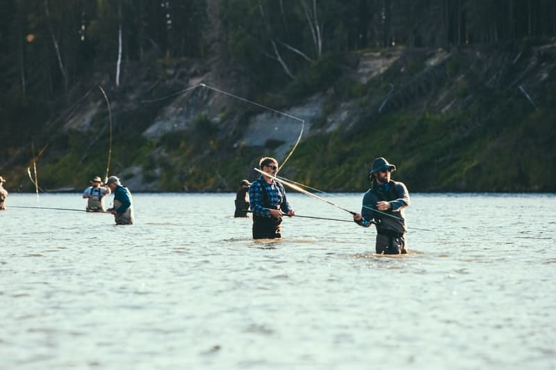 A group of people riding skis on a body of water