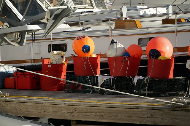 A train is parked on the side of a boat